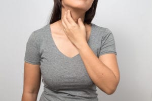Woman with neck pains