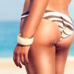 Perfect female body on beach. Get Your Best Beach Body